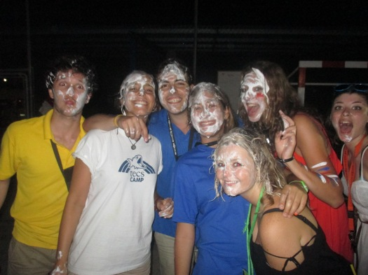 Staff with cream on faces