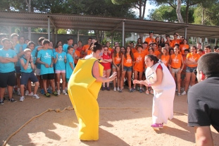 The summer camp staff playing a game of sumo wrestling during intercamp competition